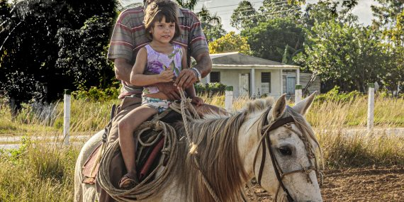 Caballero and his daughter on horseback - Vinales - Cuba photography workshops - Anchell Photography Workshops
